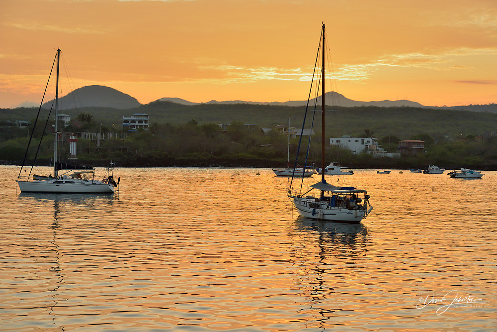 Dawn skies and moored pleasurecraft in Wreck Bay, Puerto Baquerizo Moreno, San Cristobal Island, Ecuador, Puerto Baquerizo Moreno, San Cristobal Island, Ecuador