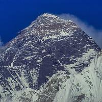 The summit of Mount Everest rises behind a ridge of Nuptse in the Khumbu region of Nepal's Himalaya.