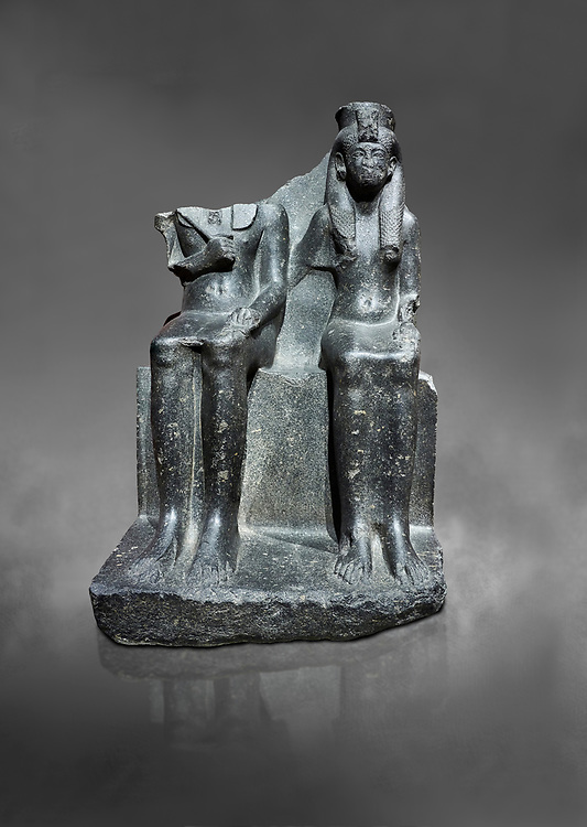 Ancient Egyptian statue of king Horemheb & his wife Mutnedjemet, granodiorite, New Kingdom, 18th Dynasty, (1319-1292 BC), Karnak, Temple of Amon. Egyptian Museum, Turin. Grey Background.<br /> <br /> Queen Mutnedjemet is depicted in the role of Hathor, the sun god, embracing her husband. The statue is unfinished with details missing including the stripes in the Royal kilt, the wings of a vulture on the queens headdress and bound enemies on one side of the throne. On the back of the throne is a long inscription recording the coronation of Horemheb who was the general of Tutenkhamun before ascending to the throne. Drovetto collection. C 1379. .<br /> <br /> If you prefer to buy from our ALAMY PHOTO LIBRARY  Collection visit : https://www.alamy.com/portfolio/paul-williams-funkystock/ancient-egyptian-art-artefacts.html  . Type -   Turin   - into the LOWER SEARCH WITHIN GALLERY box. Refine search by adding background colour, subject etc<br /> <br /> Visit our ANCIENT WORLD PHOTO COLLECTIONS for more photos to download or buy as wall art prints https://funkystock.photoshelter.com/gallery-collection/Ancient-World-Art-Antiquities-Historic-Sites-Pictures-Images-of/C00006u26yqSkDOM