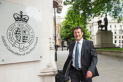 © Licensed to London News Pictures. 08/06/2015. London, UK. CHARLES SHARLAND outside the Supreme Court in London where a Supreme Court justice heard the latest round of a multi-million pound divorce cases.  Charles Sharland is accused of fraudulent non-disclosure of his fortune, by his ex-wife Alison. Photo credit: Ben Cawthra/LNP