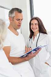 Doctors discussing patient's record