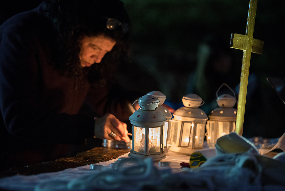 20 April 2019, Jerusalem: A congregant lights candles on the altar, as Easter Sunday sees a sunrise service at Jabal Allah (God's Mountain) on the Mount of Olives in Jerusalem, held by the Lutheran Church of the Redeemer (English-speaking congregation).