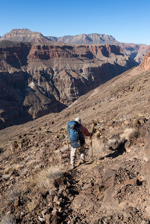 Backpacker descending the remote Lava Falls route in Grand Canyon National Park, Arizona.