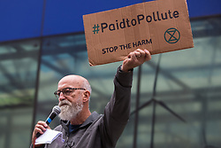 London, UK. 26th August, 2021. Jeremy Cox of Paid to Pollute addresses activists from Extinction Rebellion, Stop HS2 and XR Roads Rebellion outside the Department for Business, Energy and Industrial Strategy (BEIS) following the Stop The Harm march on the fourth day of Impossible Rebellion protests. Paid to Pollute are currently taking the Government to court regarding public payments to polluting North Sea oil and gas companies.