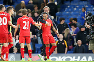 Jurgen Klopp, the Liverpool manager hugs Nathaniel Clyne of Liverpool after the final whistle.Premier league match, Chelsea v Liverpool at Stamford Bridge in London on Friday 16th September 2016.<br /> pic by John Patrick Fletcher, Andrew Orchard sports photography.