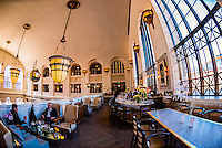 Massive arched windows, The Cooper Lounge on the mezzanine of the newly renovated Union Station in Downtown Denver, Colorado USA.