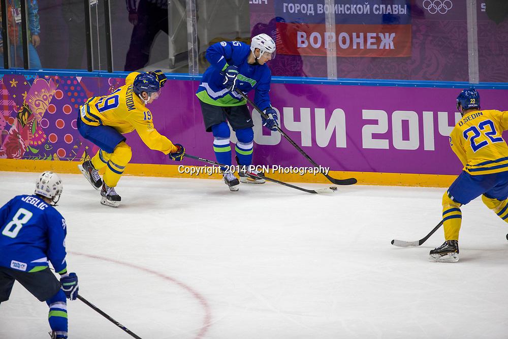 Robert Sabolic (SLO)-55, Nicklas Backstrom (SWE)-19 during Sweden vs Slovenia game at the Olympic Winter Games, Sochi 2014