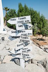 Signposts at The Island Lebanon beach resort on a man made island, part of The World off Dubai coast in  United Arab Emirates