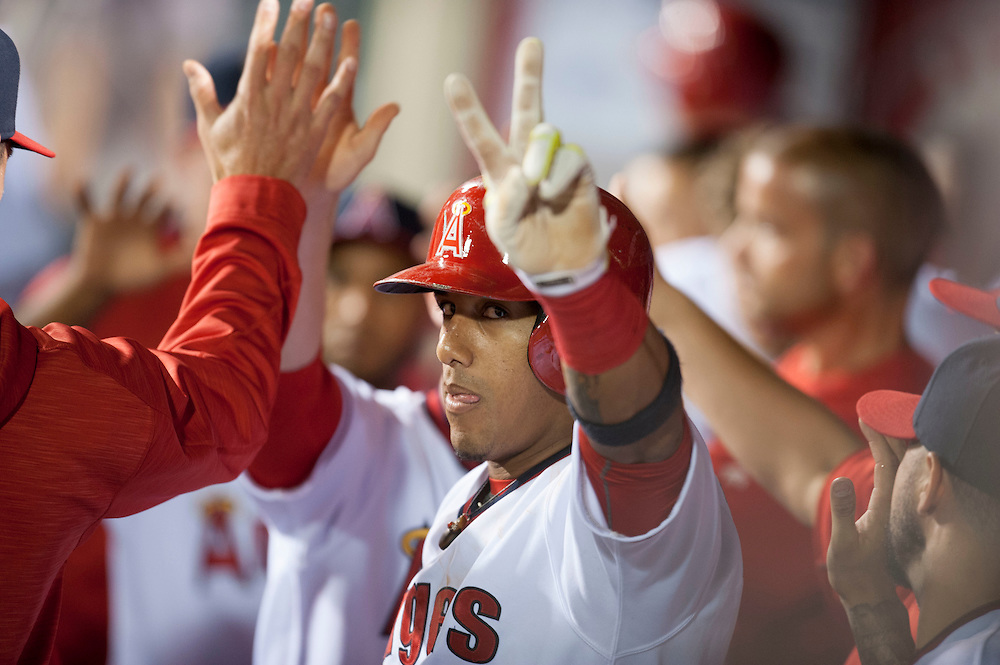 The Angels' Yunel Escobar celebrates after hitting a sac fly to score a run in the fourth inning during the Angels' 7-4 victory over the Texas Rangers at Angel Stadium on Wednesday.<br /> <br /> ///ADDITIONAL INFO:   <br /> <br /> angels.0721.kjs  ---  Photo by KEVIN SULLIVAN / Orange County Register  -- 7/20/16<br /> <br /> The Los Angeles Angels take on the Texas Rangers at Angel Stadium.