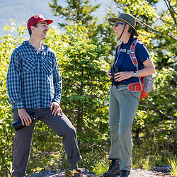 A man and woman on a hike in Jackson, New Hampshire. White Mountains.