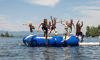 A group of local youngsters enjoy Lake Winnipesaukee at Glendale on Friday afternoon.  (Karen Bobotas/for the Laconia Daily Sun)