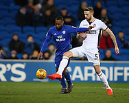 Mark Beevers of Bolton Wanderers ® challenges Junior Hoilett of Cardiff City. EFL Skybet championship match, Cardiff city v Bolton Wanderers at the Cardiff city Stadium in Cardiff, South Wales on Tuesday 13th February 2018.<br /> pic by Andrew Orchard, Andrew Orchard sports photography.