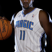"""Glen """"Big Baby"""" Davis poses in front of a backdrop during the Orlando Magic media day event at the Amway Arena on Monday, September 30, 2103 in Orlando, Florida. (AP Photo/Alex Menendez)"""