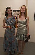 Sienna Guillory and Alicia Witt, The Shape of Things, first night party. Photographers Gallery, 17 May 2004. ONE TIME USE ONLY - DO NOT ARCHIVE  © Copyright Photograph by Dafydd Jones 66 Stockwell Park Rd. London SW9 0DA Tel 020 7733 0108 www.dafjones.com
