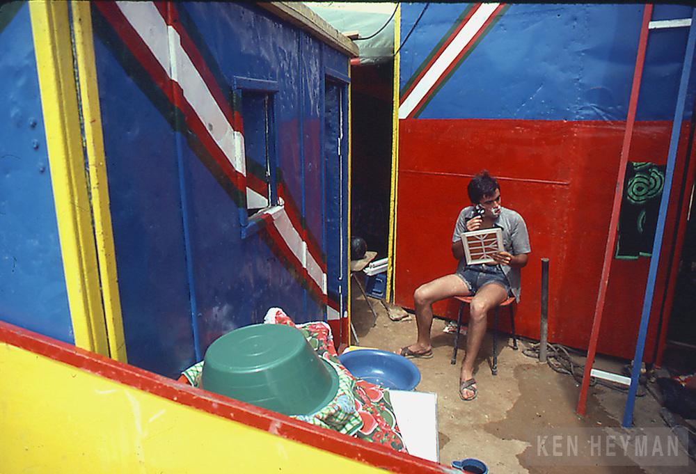 A village festival in Portugal--a man shaving.