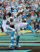 Carolina Panthers quarterback Cam Newton (1) celebrates after leaping head over heels into the end zone on a 2 yard touchdown run good for a 17-10 third quarter lead during the 2015 NFL week 2 regular season football game against the Houston Texans on Sunday, Sept. 20, 2015 in Charlotte, N.C. The Panthers won the game 24-17. (©Paul Anthony Spinelli)