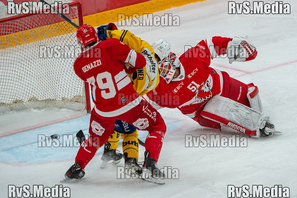 LAUSANNE, SWITZERLAND - SEPTEMBER 24: Yannick Frehner #93 of HC Davos tries to score against Goalie Tobias Stephan #51 of Lausanne HC and Joel Genazzi #79 during the Swiss National League game between Lausanne HC and HC Davos at Vaudoise Arena on September 24, 2021 in Lausanne, Switzerland. (Photo by Robert Hradil/RvS.Media)