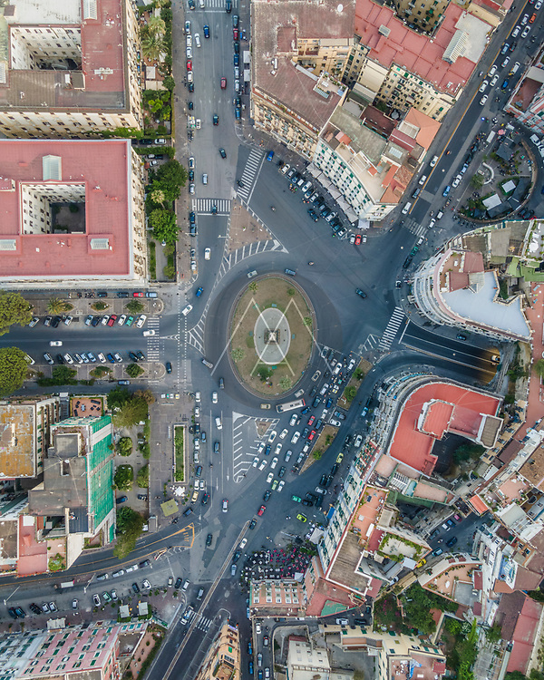 Aerial view of a roundabout with vehicles in Naples downtown, Naples, Campania, Italy.