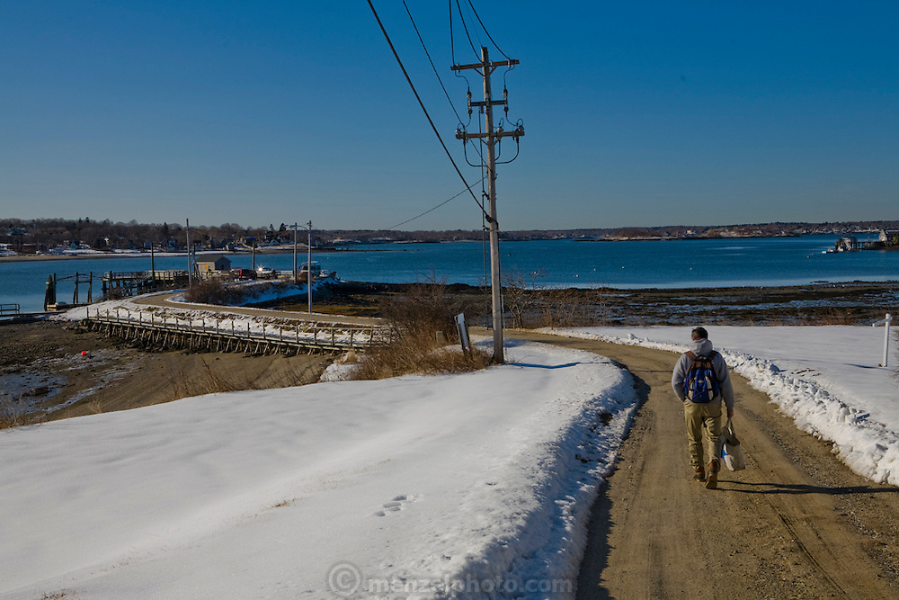 Sam Tucker, lobsterman and fish buyer at Portland Maine Fish Exchange on Great Diamond Island in Portland, Maine, heads to work. (Samuel Tucker is featured in the book What I Eat: Around the World in 80 Diets.)  MODEL RELEASED.