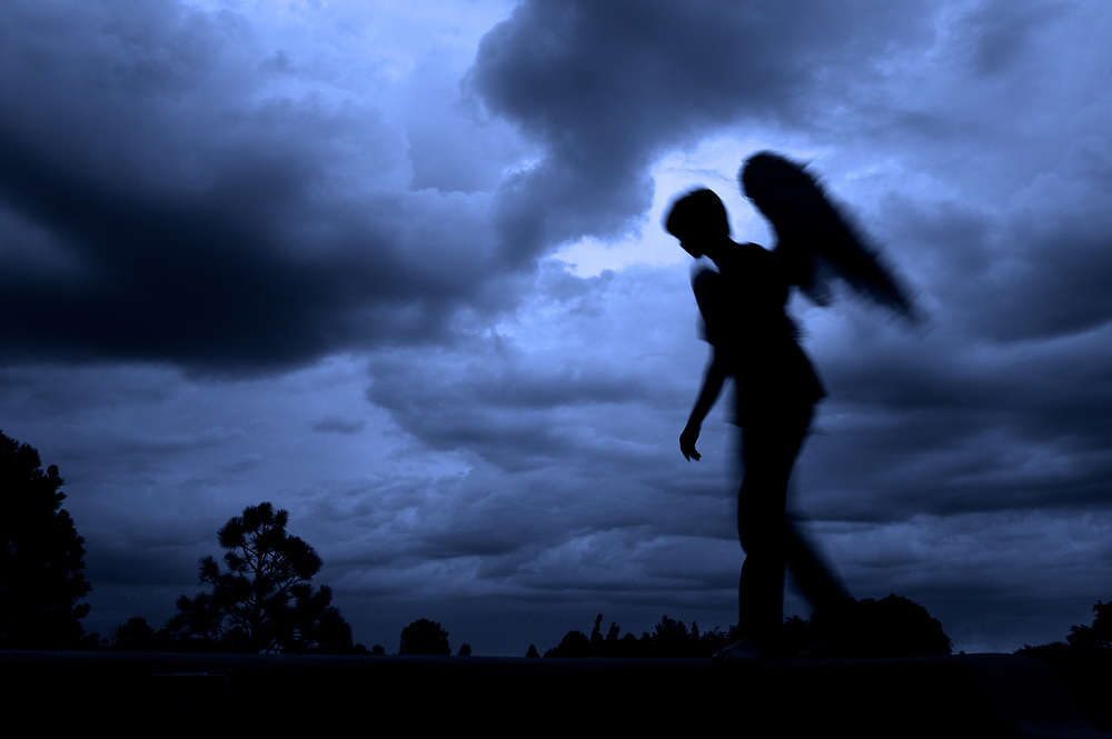 Angel silhouette and storm clouds, Arroyo Seco, New Mexico