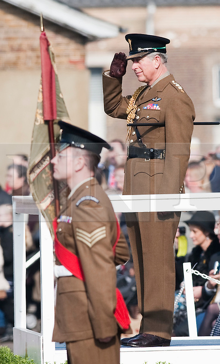 © Licensed to London News Pictures. 01/03/2012. Hounslow, UK.  HRH  Prince Charles giving a salute to the Welsh Guards as they parade at Cavalry Barracks,  Hounslow, London on St David's Day, March 1st, 2012.  The Prince of Wales presented  1st Battalion The Welsh Guards with leaks. Two-thirds of the Battalion's 600 soldiers are due to be deployed to Afghanistan in the next two weeks. Photo credit : Ben Cawthra/LNP