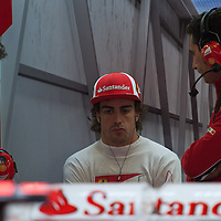 Ferrari Formula One driver Fernando Alonso (C) of Spain sits in the pit before the free practice session of the Hungarian F1 Grand Prix in Mogyorod (about 20km north-east from Budapest), Hungary. Thursday, 28. July 2011. ATTILA VOLGYI
