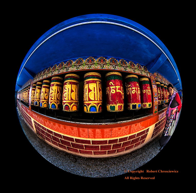 """Circle of Life (in Black): Tibetan prayer wheels repeat the Om-Ma-Ni-Padme-Hum mantra to the Buddhist faithful, reinforcing the concept of the """"Circle of Life"""", McLeod-Ganj India.<br /> <br /> (Mani means """"jewel"""" or """"bead"""" and Padma means """"the lotus flower"""")"""