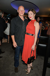 The UK Premier of Johnnie Walker Blue Label's 'Gentleman's Wager' - a short film starring Jude Law was held at The Bulgari Hotel & Residences, 171 Knightsbridge, London on 22nd July 2014.<br /> Picture Shows:-CAMILLA RUTHERFORD and DOMINIC BURNS.