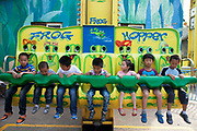 Young children enjoying a gentle 'Frog; Hopper' ride. Happy Valley Beijing is an amusement park in Beijing, China built and operated by Beijing OTC, which is part of the Shenzhen OCT Holding Group. The park, which is located in the east of Beijing, opened in July, 2006. It is one of four theme parks in the brand chain. Similar in style with the Disney land park, Happy Valley Beijing also featured distinctive landscapes and themes throughout the resort along with featured rides within the different themes. In total there are more than 40 rides.