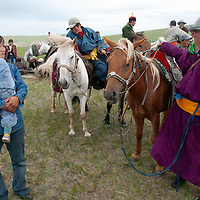 Nomadic herders at a naadam festival on a remote pass in Arbulag Sum, near Muren in Hovsgol Aimag, Mongolia.