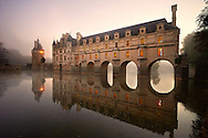 The Chateau de Chenonceau at sunset designed by French Renaissance architect Philibert de l'Orme 1555 by  to span the River Char. Loire Valley. Chenonceaux,  Indre-et-Loire département France. .<br /> <br /> Visit our EARLY MODERN ERA HISTORICAL PLACES PHOTO COLLECTIONS for more photos to buy as wall art prints https://funkystock.photoshelter.com/gallery-collection/Modern-Era-Historic-Places-Art-Artefact-Antiquities-Picture-Images-of/C00002pOjgcLacqI