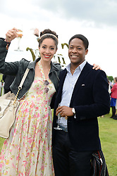 OONA CHAPLIN and ADETOMAWI EDUN at the 2013 Cartier Queens Cup Polo at Guards Polo Club, Berkshire on 16th June 2013.