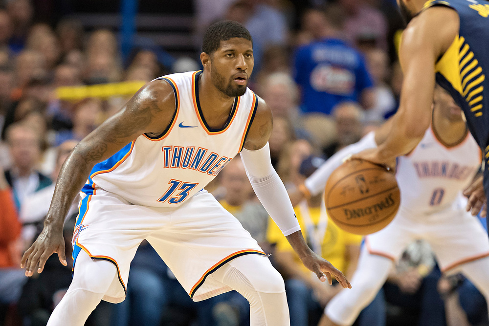 OKLAHOMA CITY, OK - OCTOBER 25:  Paul George #13 of the Oklahoma City Thunder playing defense during a game against the Indiana Pacers at the Chesapeake Energy Arena on October 25, 2017 in Oklahoma City, Oklahoma.  NOTE TO USER: User expressly acknowledges and agrees that, by downloading and or using this photograph, User is consenting to the terms and conditions of the Getty Images License Agreement.  The Thunder defeated the Pacers 114-96.  (Photo by Wesley Hitt/Getty Images) *** Local Caption *** Paul George