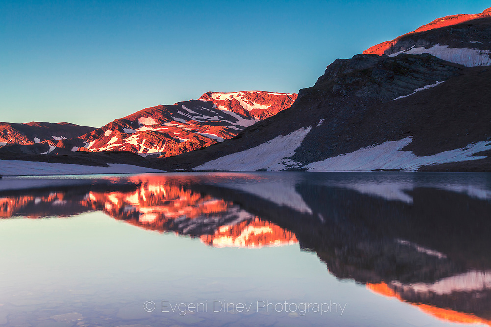 Reflections of a mountain in a crystal clear lake