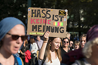 """13 OCT 2018, BERLIN/GERMANY:<br /> Demonstratin mit Plakat """"Hass ist keine Meinung"""", Demonstration """"#unteilbar"""" - """"Solidaritaet statt Ausgrenzung - fuer eine offene und freie Gesellschaft"""", Gertraudenstrasse / Strasse des 17. Juni<br /> IMAGE: 20181013-01-005<br /> KEYWORDS: Demo"""
