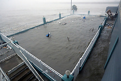 August 26, 2017 - Port Lavaca, Texas, U.S. - The overflowing pool at the Holiday Inn Express in Port Lavaca, Texas is inundated Saturday by storm surge waters from Hurricane Harvey which made landfall about 50 miles away in Rockport, Texas as a Category 4 storm. (Credit Image: © San Antonio Express-News via ZUMA Wire)