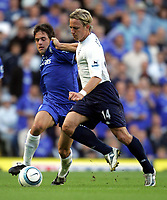 FA BARCLAYCARD PREMIERSHIP. SUNDAY 19 SEPT 2004<br /> CHELSEA V SPURS<br /> PIC BY KARL WINTER/FOTOSPORTS<br /> CHELSEA'S JOE COLE GETS TO GRIPS WITH SPURS ERIK EDMAN<br /> NORWAY ONLY