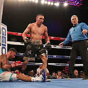 NEW ORLEANS, LA - JULY 14:  Teofimo Lopez (R) hovers over a fallen Willian Silva during the Regis Prograis v Juan Jose Velasco ESPN boxing match at the UNO Lakefront Arena on July 14, 2018 in New Orleans, Louisiana.  (Photo by Alex Menendez/Getty Images) *** Local Caption *** Teofimo Lopez; Willian Silva