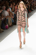 Dress with a lace hem and long lace vest. By Custo Barcelona at the Spring 2013 Fashion Week show in New York.