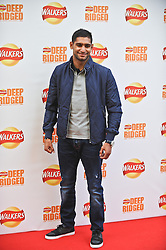 © Licensed to London News Pictures. 29/08/2012. London,UK. Boxer Amir Khan attending the launch Walkers news Deep Ridged crisps. To celebrate the launch Walkers unveiled 'Britain's Biggest Ever Crisp' standing at 22m tall .Photo credit : Thomas Campean/LNP. .