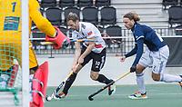 AMSTELVEEN - Mirco Pruyser (Amsterdam)  met Pieter Sutorius (Pinoke)    tijdens   hoofdklasse hockeywedstrijd mannen,  AMSTERDAM-PINOKE (1-3) , die vanwege het heersende coronavirus zonder toeschouwers werd gespeeld. COPYRIGHT KOEN SUYK