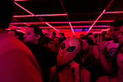 A group of teenagers enjoy a Hallowen party in Victoria, a disco of techno music. In Colombia most of this generation tends to listen to electronic music (in its different variables) or latin trap.