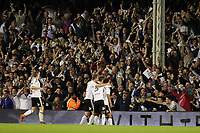 LONDON, ENGLAND - MAY 14:LONDON, ENGLAND - MAY 14:Fulham fans celebrate there teams 2nd goal of the night