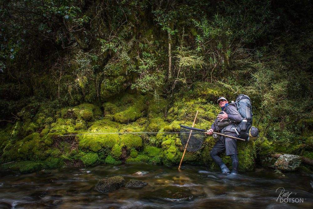 Guide Sean Andrews treks along a wilderness section of river.