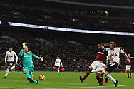 Harry Kane of Tottenham Hotspur's (R) has a shot at goal is saved by Adrian, the goalkeeper of West Ham United (L). Premier league match, Tottenham Hotspur v West Ham United at Wembley Stadium in London on Thursday  4th January 2018.<br /> pic by Steffan Bowen, Andrew Orchard sports photography.