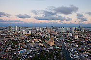 Aerial view of downtown Miami and the Miami River at twilight