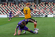 Newport County's Ryan Haynes (3) under pressure from Tranmere Rover's Kieron Morris (7) during the EFL Sky Bet League 2 match between Newport County and Tranmere Rovers at Rodney Parade, Newport, Wales on 17 October 2020.
