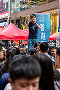 Yellow Umbrella activist Joshua Wong speaks to protesters as they gather in the streets from Victoria Park to Central to protest against the extradition bill, and police use of force during a recent riot, and demand for Chief Executive Carrie Lam's resignation, besides other concerns, in Hong Kong on July 1st, 2019. Photo by Suzanne Lee/PANOS