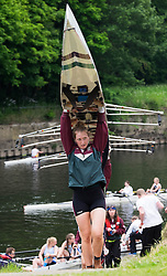 © Licensed to London News Pictures.13/06/15<br /> Durham, England<br /> <br /> A crew carry their boat from the water during the 182nd Durham Regatta rowing event held on the River Wear. The origins of the regatta date back  to commemorations marking victory at the Battle of Waterloo in 1815. This is the second oldest event of this type in the country and attracts over 2000 competitors from across the country.<br /> <br /> Photo credit : Ian Forsyth/LNP