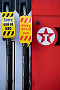 As the fuel transport crisis continues into its second week, sealed Texaco petrol and diesel pumps are covered in a closed petrol and fuel station in south London, on 27th September 2021, in London, England. The shortages at retailers around the country are caused by the UKs lack of qualified HGV Heavy Goods Vehicles drivers who deliver supplies to the nations fuel forecourts, the majority of which are now closed after panic-buying drained fuel stock.